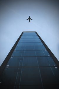 Airplane and building, low angle
